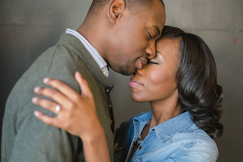 Intimate portrait of an african-american couple in love by Jakob for Stocksy United