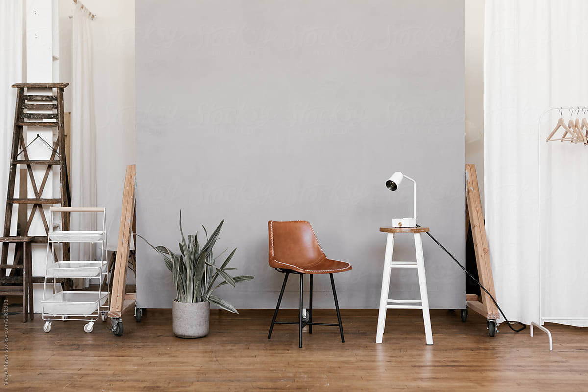Photo Studio Props Set Up In Front Of Cement Grey Backdrop Wall By Nicole Mason Stocksy United