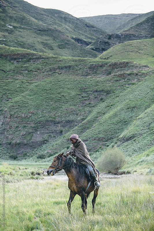 young Basotho herdsman with his horse in the Lesotho highlands by Micky Wiswedel for Stocksy United