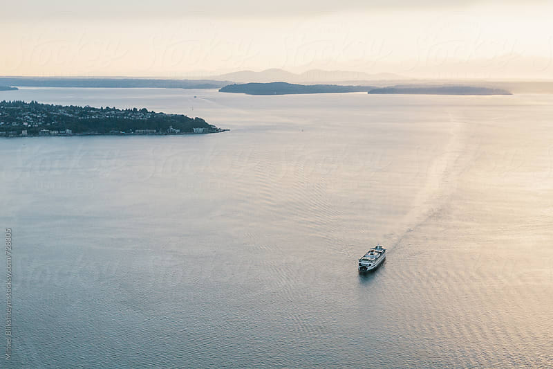 Aerial view of Washington State ferry and Puget Sound with setting sun by Mihael Blikshteyn for Stocksy United