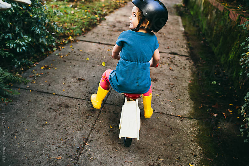 Girl on a bike by Ali Lanenga for Stocksy United