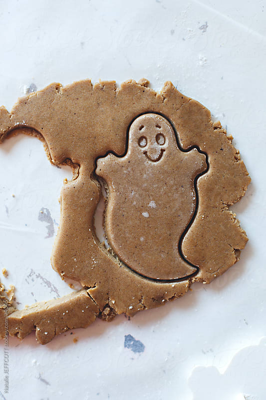 baking gingerbread ghost cookies for Halloweem by Natalie JEFFCOTT for Stocksy United