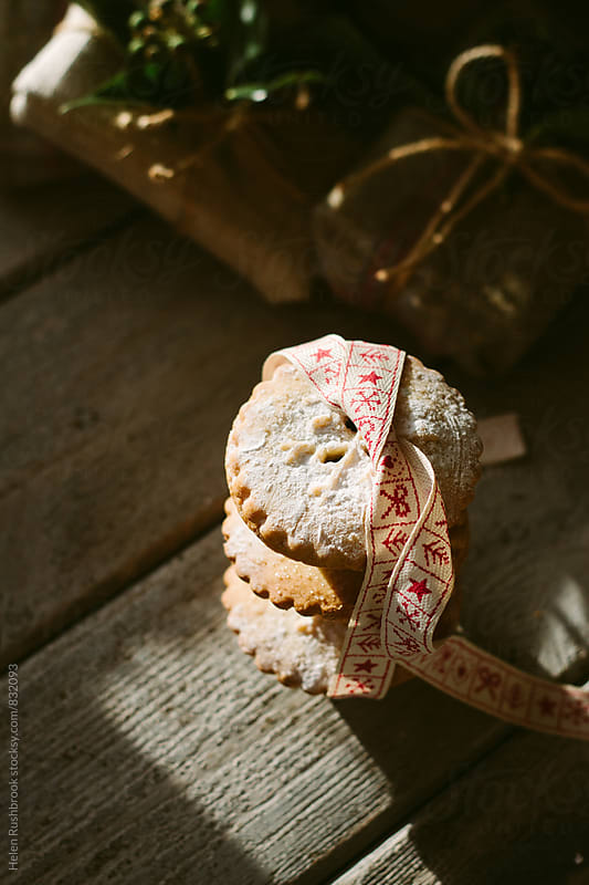 Mince pies and Christmas ribbon by Helen Rushbrook for Stocksy United