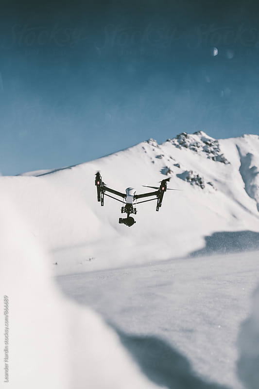 drone landing in snowcovered mountain landscape by Leander Nardin for Stocksy United