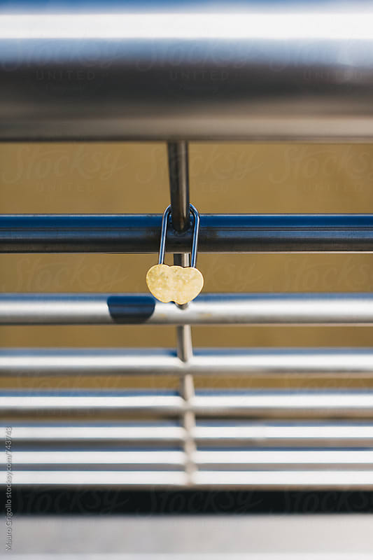 Love padlock on a fence by Mauro Grigollo for Stocksy United