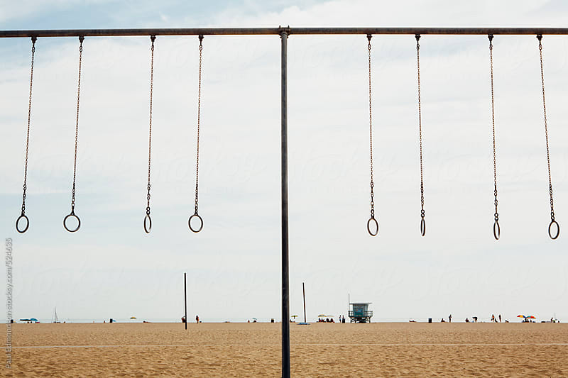 Exercise equipment along beach in Santa Monica, Pacific Ocean in distance, Los Angeles, CA, USA by Paul Edmondson for Stocksy United