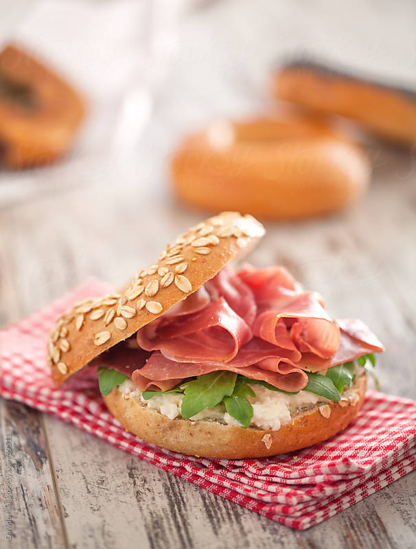 Bagel with ham, salad & cheese by Davide Illini for Stocksy United