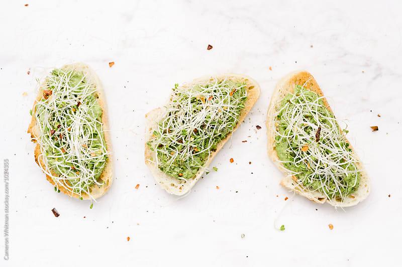 Spring Pea Roasted Garlic Bruschetta by Cameron Whitman for Stocksy United