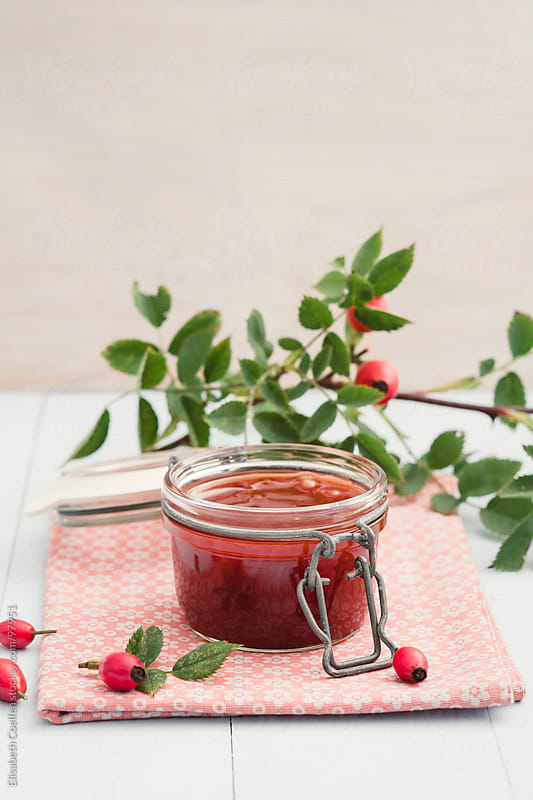 Homemade rose hip jelly in a jar by Elisabeth Coelfen for Stocksy United