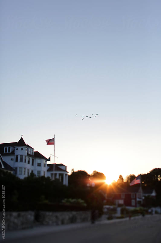 At Sunrise, Geese Fly Over Victorian Cottages On Mackinac Island Michgan by ALICIA BOCK for Stocksy United