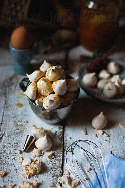 Very grainy meringues with honey still life by Natasa Kukic for Stocksy United