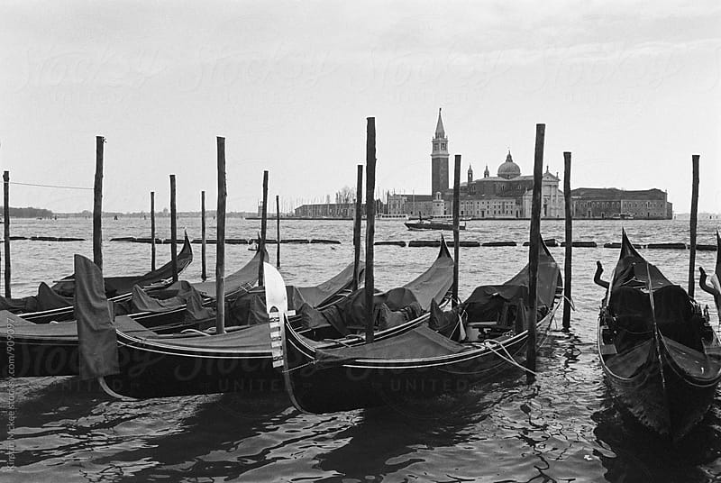 Gondolas in the lagoon, Venice by Kirstin Mckee for Stocksy United