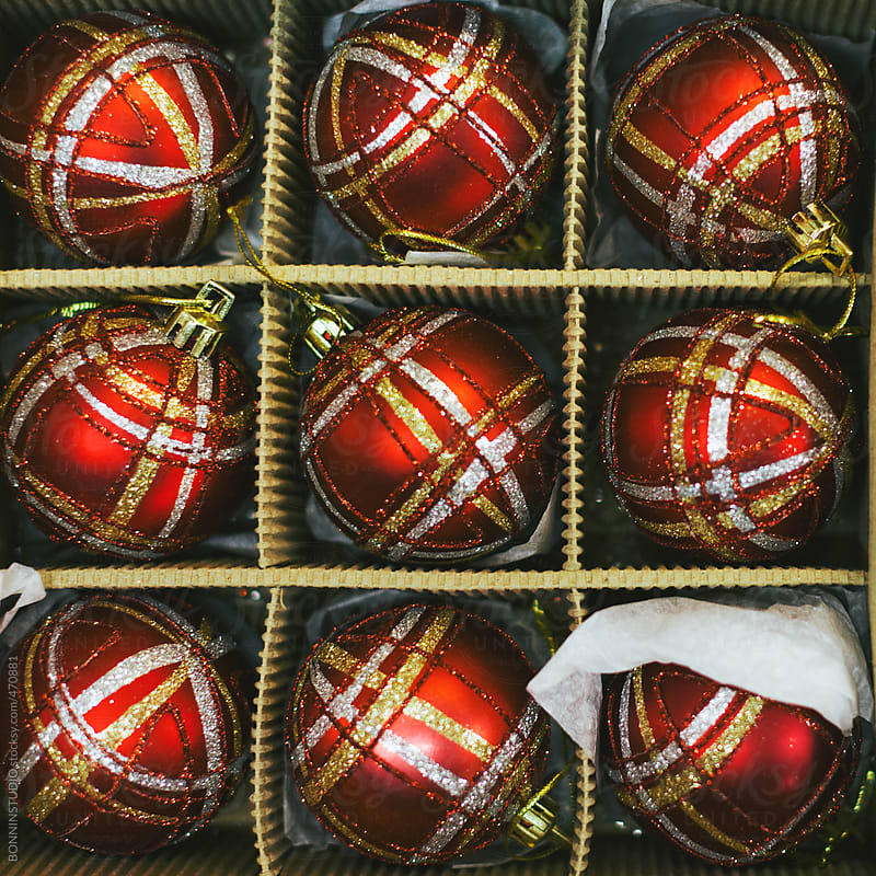 Box of Christmas balls ornaments for sale on a marketplace. by BONNINSTUDIO for Stocksy United