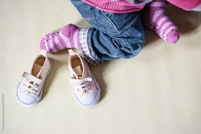 Objects: Little yellow sneakers and child's feet by Ina Peters for Stocksy United