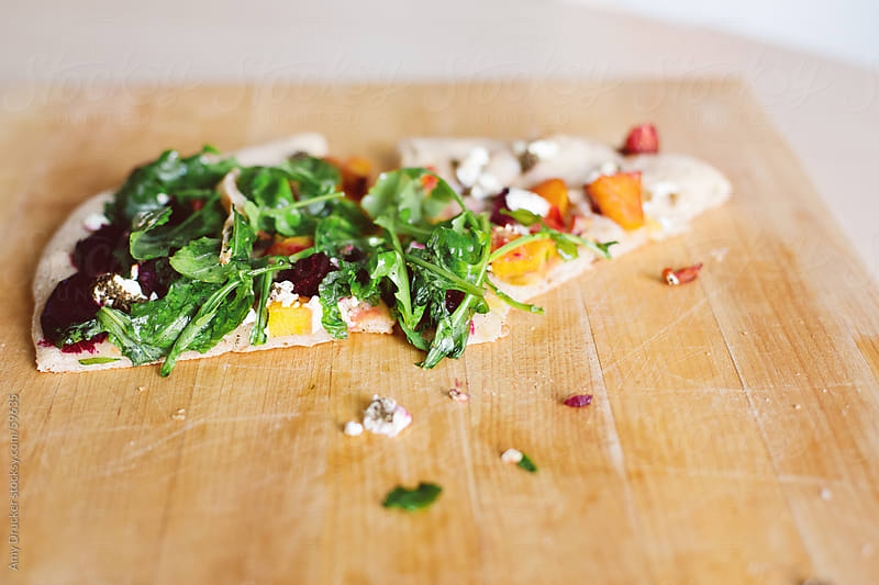 Homemade Pizza with Greens and Vegetables  by Amy Drucker for Stocksy United