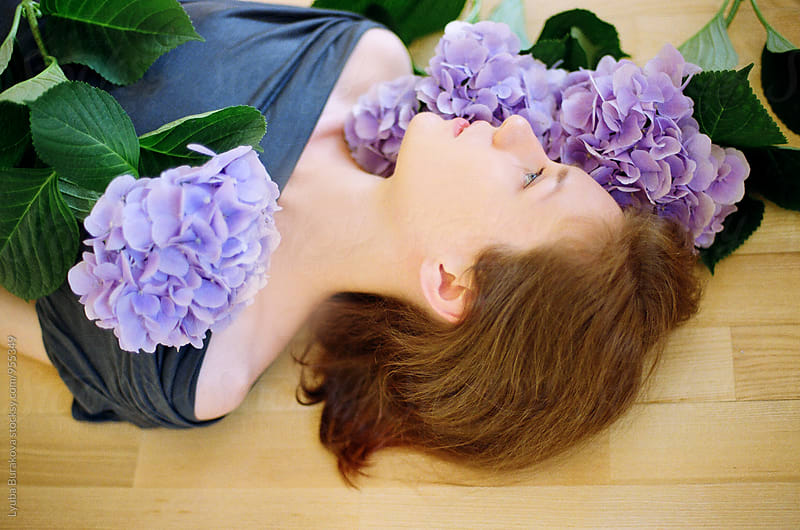 Portrait of young woman with flowers by Lyuba Burakova for Stocksy United