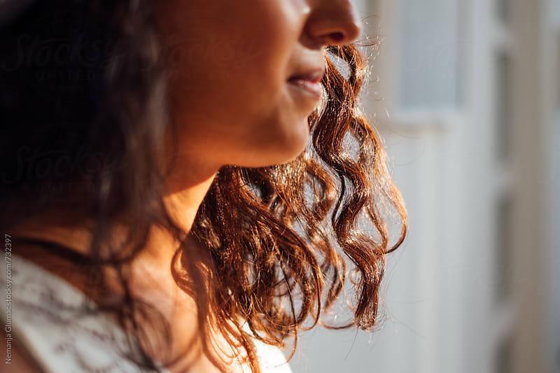Curls on Bolivian Brunette Teen by Nemanja Glumac for Stocksy United