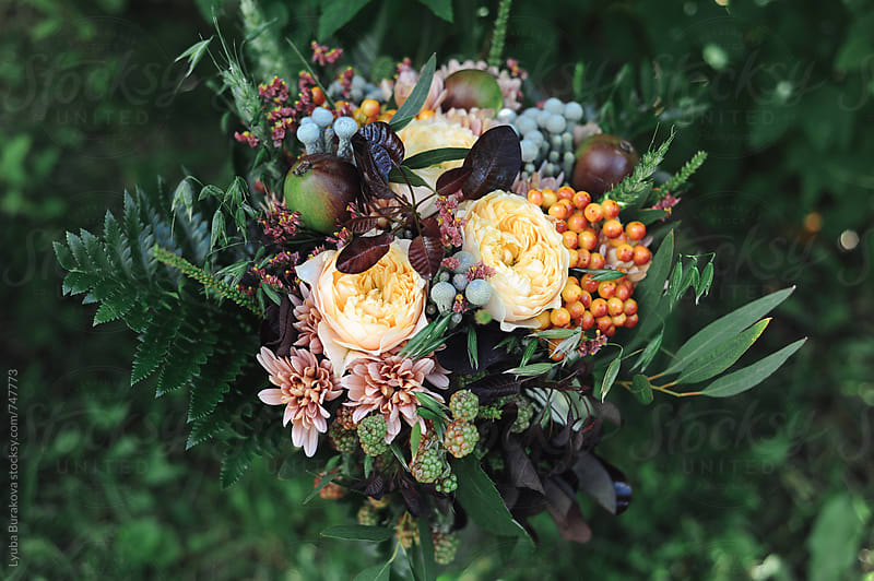 Wedding bouquet on green grass  by Liubov Burakova for Stocksy United