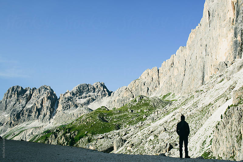 Silhouette of hiker on the mountain by michela ravasio for Stocksy United
