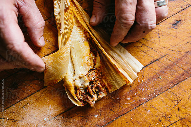 Masa Tamale in corn husk by Andrew Cebulka for Stocksy United