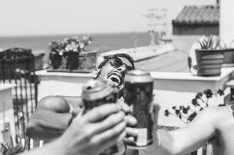 cheers,three friends toasting, beer,fun,happiness by Igor Madjinca for Stocksy United