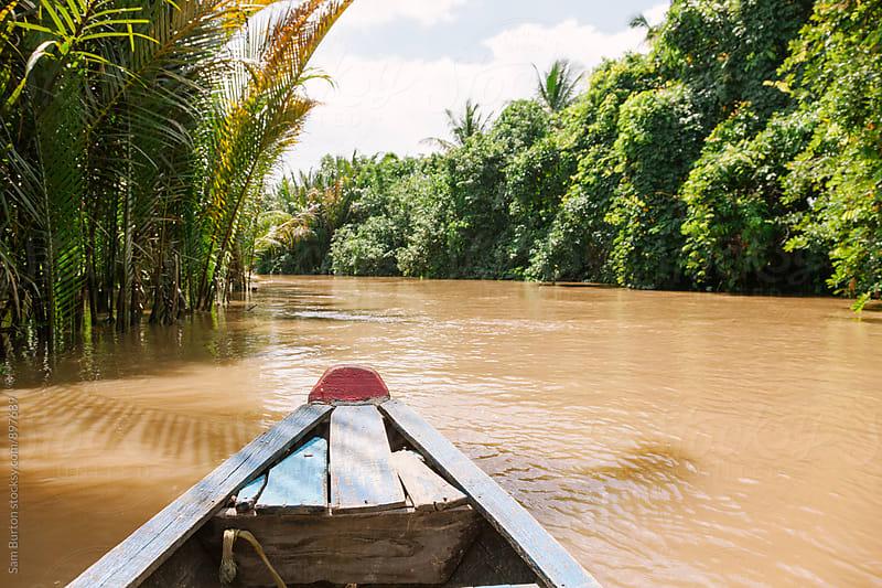 Canoe in the mekong delta by Sam Burton for Stocksy United