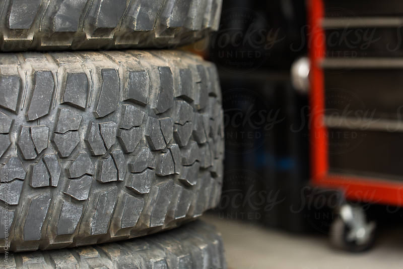 Close up of used off road vehicle tires by Amy Covington for Stocksy United