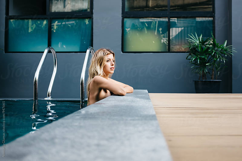 Pretty Blond Woman Relaxing in a Pool by Nemanja Glumac for Stocksy United