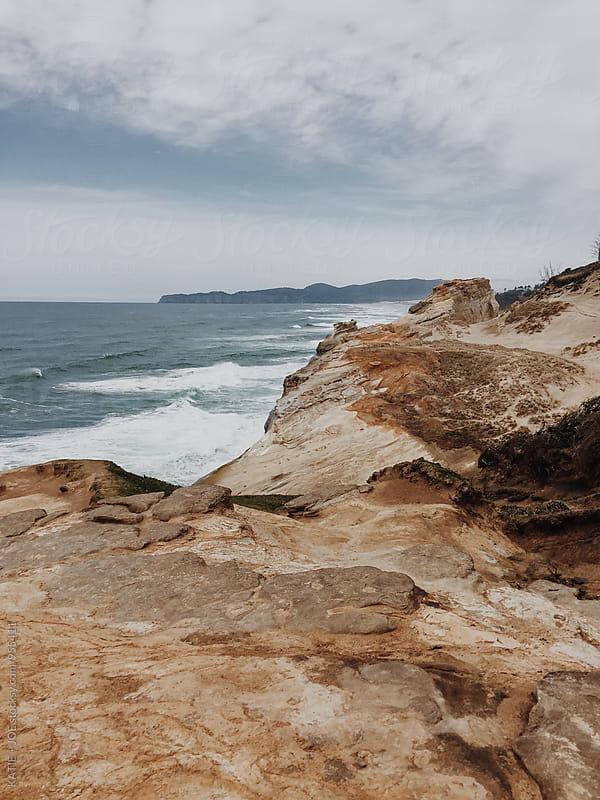 Landscape. Rocky terrain overlooking the ocean.  by KATIE + JOE for Stocksy United
