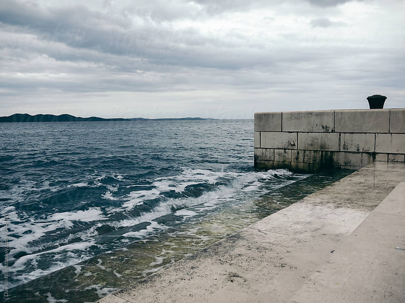 Jetty on the sea by Davide Illini for Stocksy United