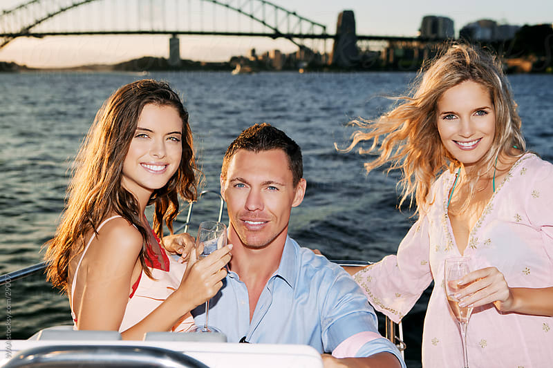 Group of friends having fun on a yacht by WAA for Stocksy United