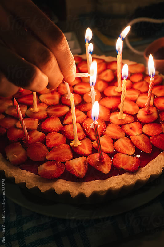 Birthday Cake With A With Burning Candles  by Alexander Grabchilev for Stocksy United