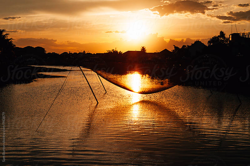 Sunset in Hoi An by Sam Burton for Stocksy United