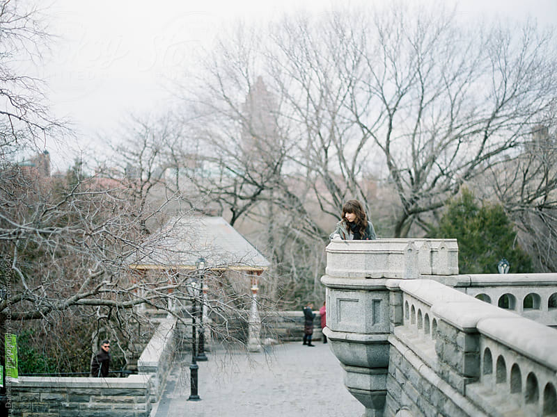 Woman sitting on building in Central Park by Daniel Kim Photography for Stocksy United