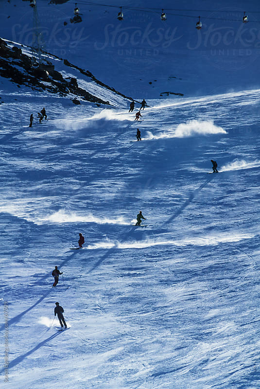 Active people skiing on wide slope in the mountains by Soren Egeberg for Stocksy United