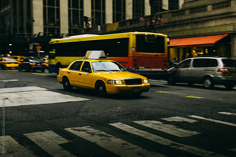 Taxi driving in New York city. by BONNINSTUDIO for Stocksy United