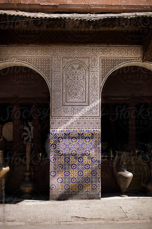 Tiled shop front in the medina in Marrakech. by Darren Muir for Stocksy United
