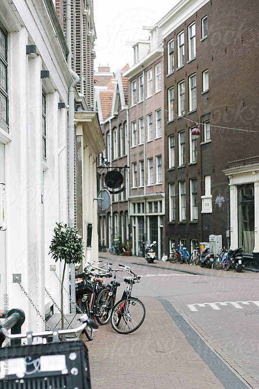 Empty side street of Amsterdam by Toma Evsiukova for Stocksy United