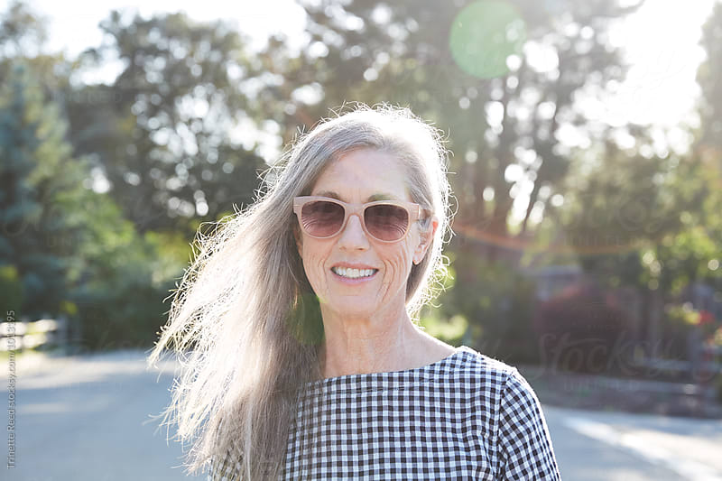 Portrait of stylish senior woman with grey hair outdoors by Trinette Reed for Stocksy United