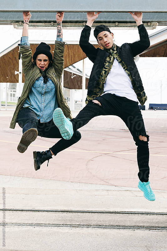 Young alternative man and woman having fun outside. by BONNINSTUDIO for Stocksy United