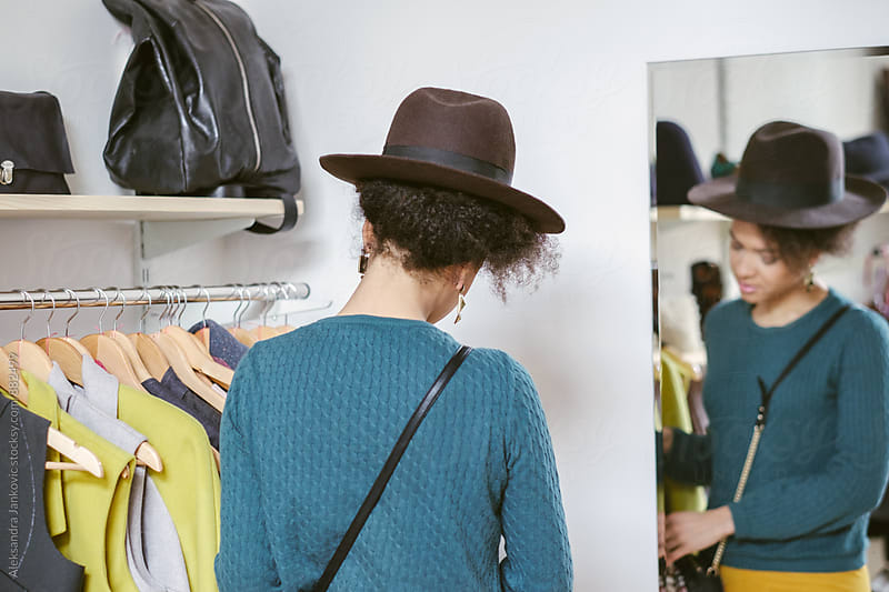 Woman with Hat Shopping in the Clothing Store by Aleksandra Jankovic for Stocksy United