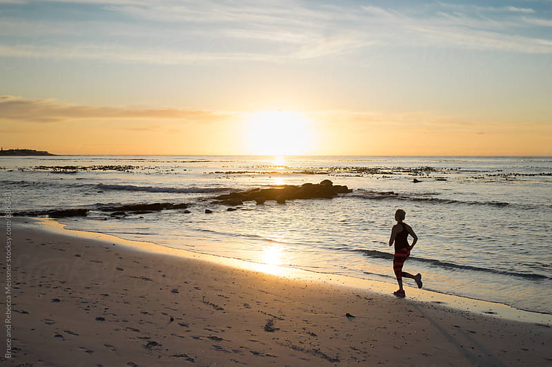 Running on the Beach by Bruce and Rebecca Meissner for Stocksy United