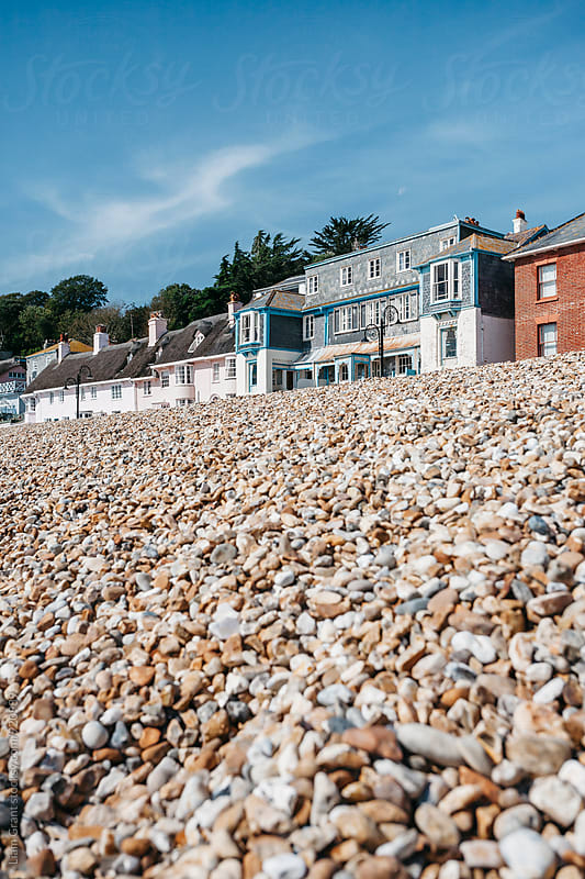 Buildings on the seafront and pebble beach at Lyme Regis, Devon, UK. by Liam Grant for Stocksy United