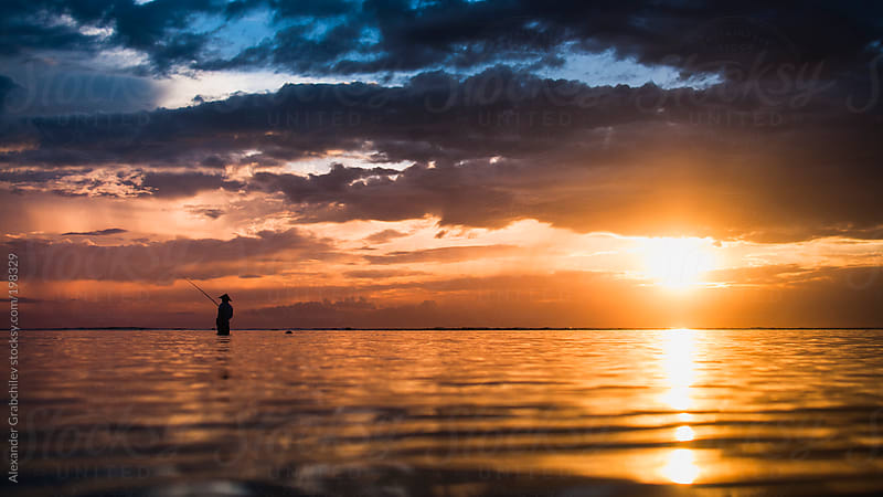Sunrise Seascape  With  Fisherman Silhouette by Alexander Grabchilev for Stocksy United