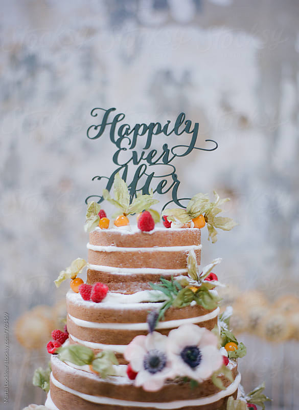 Naked Wedding Cake with berries by Marta Locklear for Stocksy United