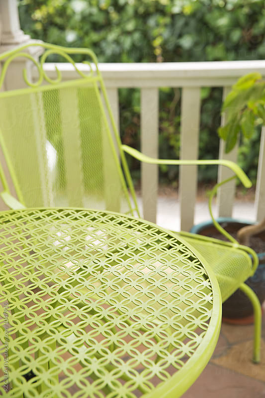 Green chair and table outdoors. by RZ CREATIVE for Stocksy United