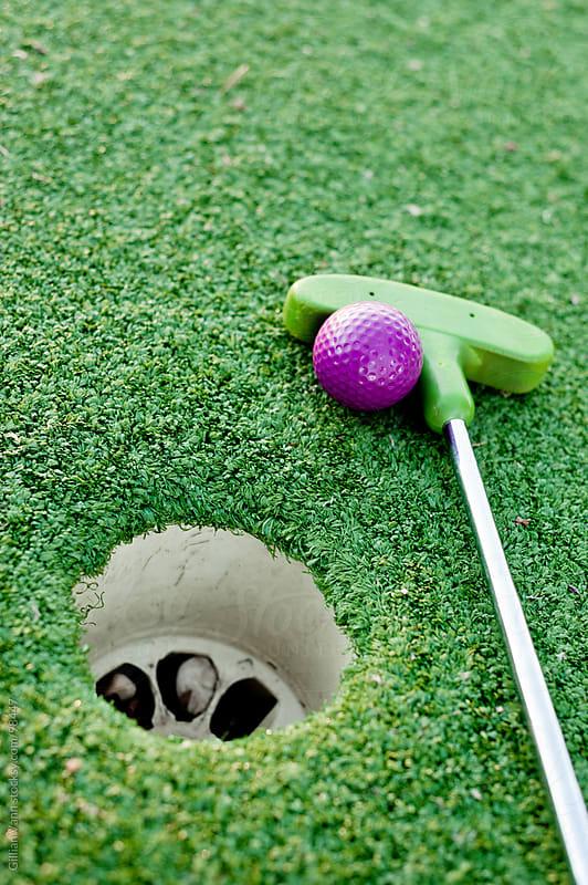 mini golf club by Gillian Vann for Stocksy United