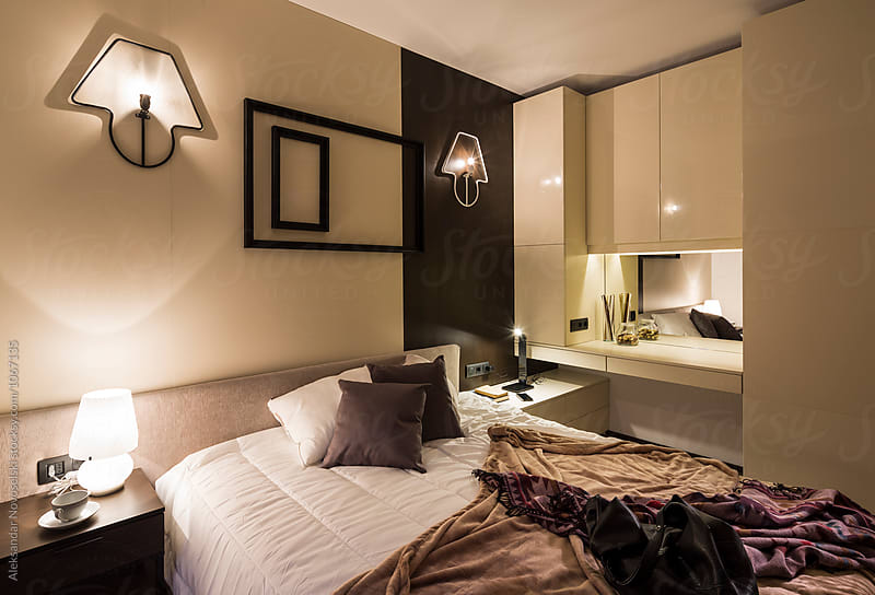 Cosy bedroom by night by Aleksandar Novoselski for Stocksy United
