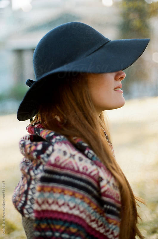 Young woman wearing blue hat by Lyuba Burakova for Stocksy United