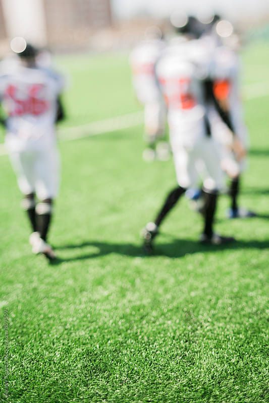 players on the field, tilt-shift lens by Alexey Kuzma for Stocksy United